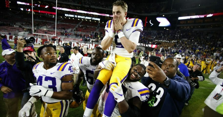 LSU quarterback Joe Burrow (9) is carried off the field by his teammates after defeating Alabama 46-41 in an NCAA college football game on Nov. 9, 2019, in Tuscaloosa , Alabama.