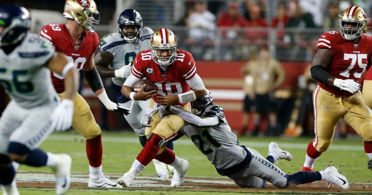 Tre Flowers of the Seattle Seahawks sacks Jimmy Garoppolo of the San Francisco 49ers during Seattle's 27-24 victory at Levi's Stadium on Nov. 11, 2019. The two teams meet again Sunday night