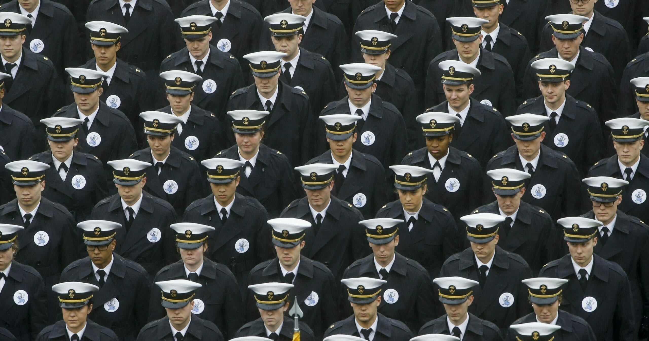 Navy midshipmen march onto the field ahead of the college football game between Army and Navy in Philadelphia on Dec. 14, 2019.
