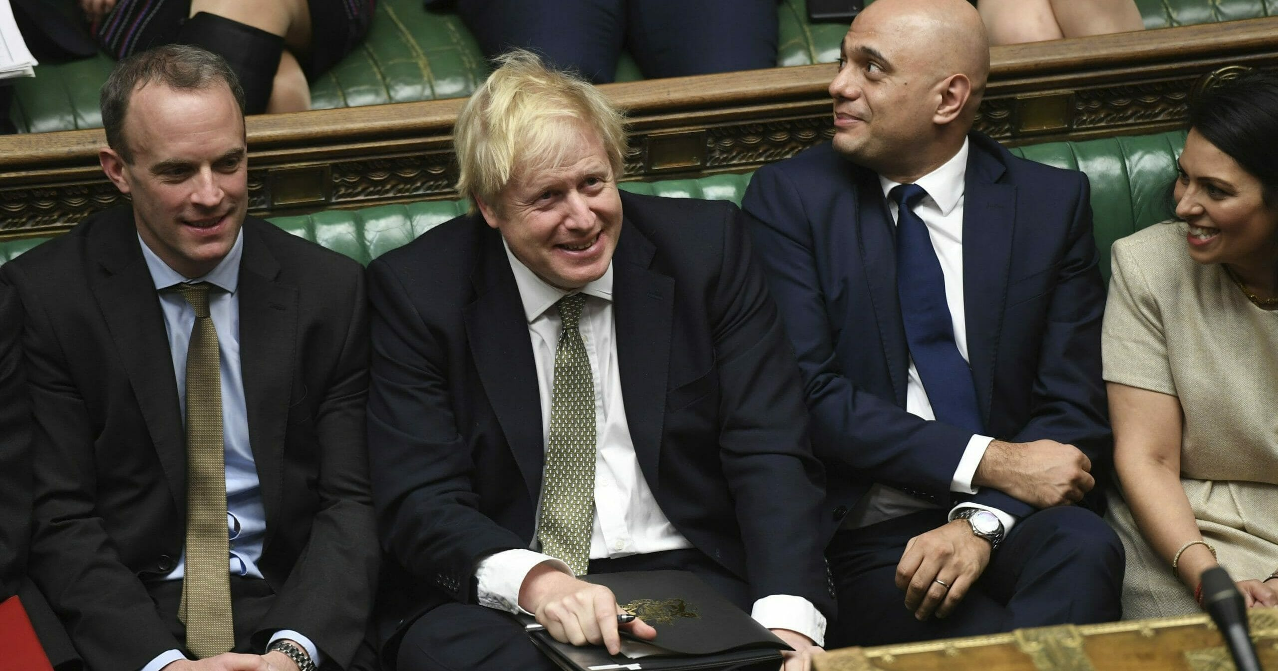 British Prime Minister Boris Johnson, center, attends the debate in the House of Commons in London on Dec. 19, 2019.