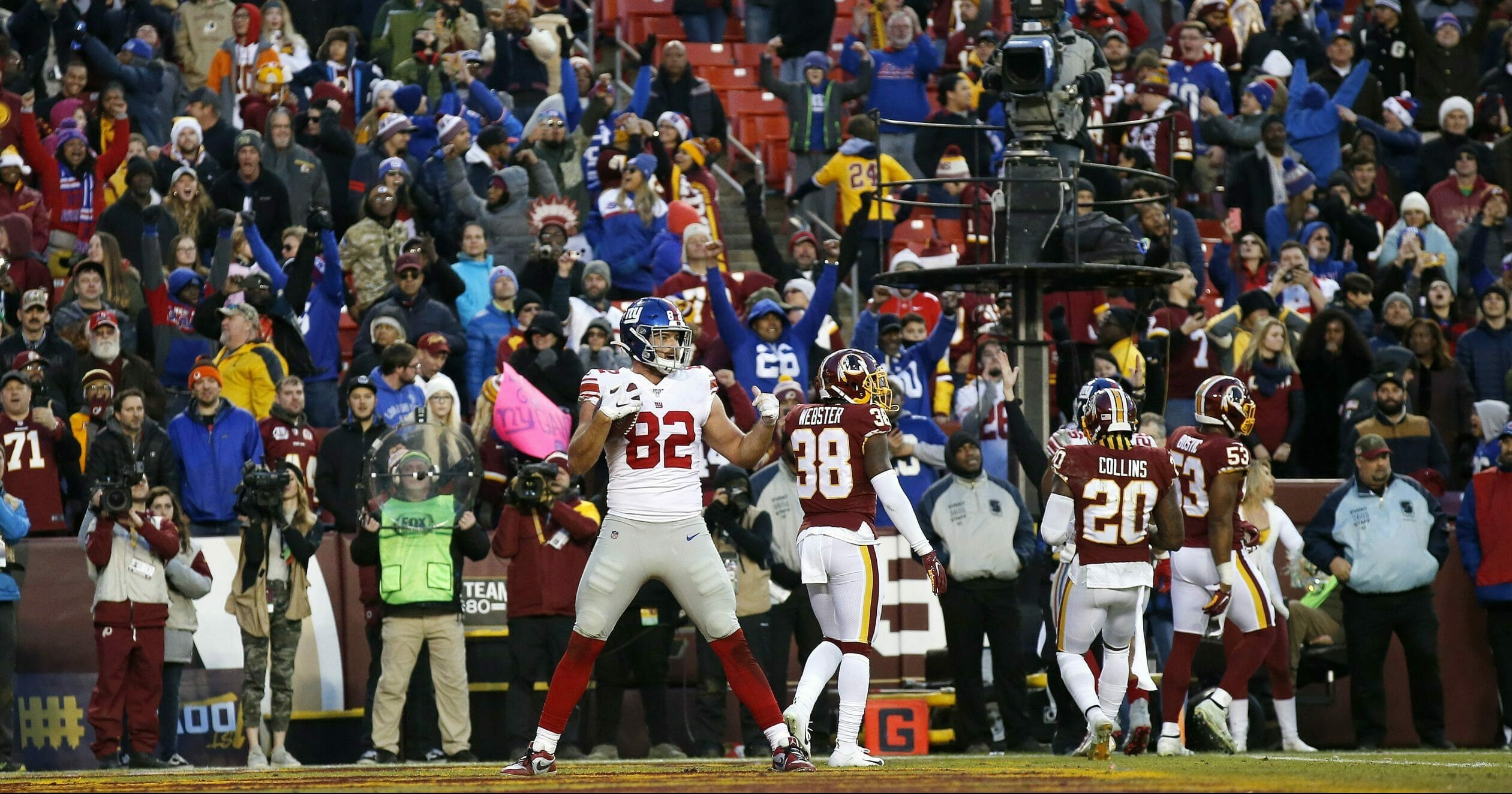 Fans react along with New York Giants tight end Kaden Smith after he caught a game-winning touchdown pass from quarterback Daniel Jones in overtime of a game against the Washington Redskins on Dec. 22, 2019, in Landover, Maryland.