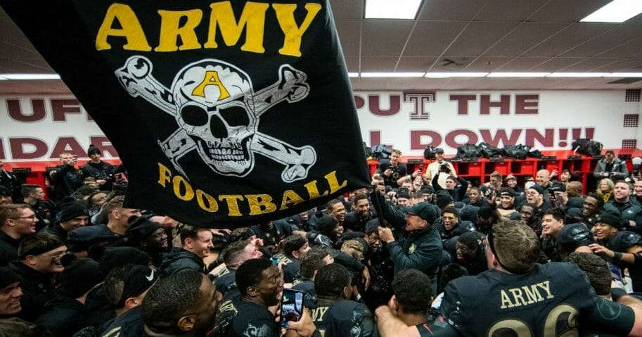 Jeff Monken, head coach of the Army Black Knights, waves a flag in the locker room after defeating the Navy Midshipmen at Lincoln Financial Field on Dec. 8, 2018, in Philadelphia, Pennsylvania.