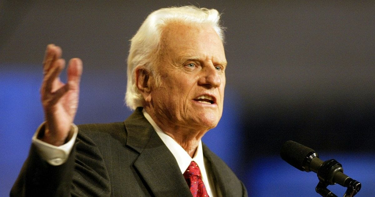 The Rev. Billy Graham speaks during the first day of a four-day revival meeting Oct. 17, 2002, at Texas Stadium in Irving, Texas.