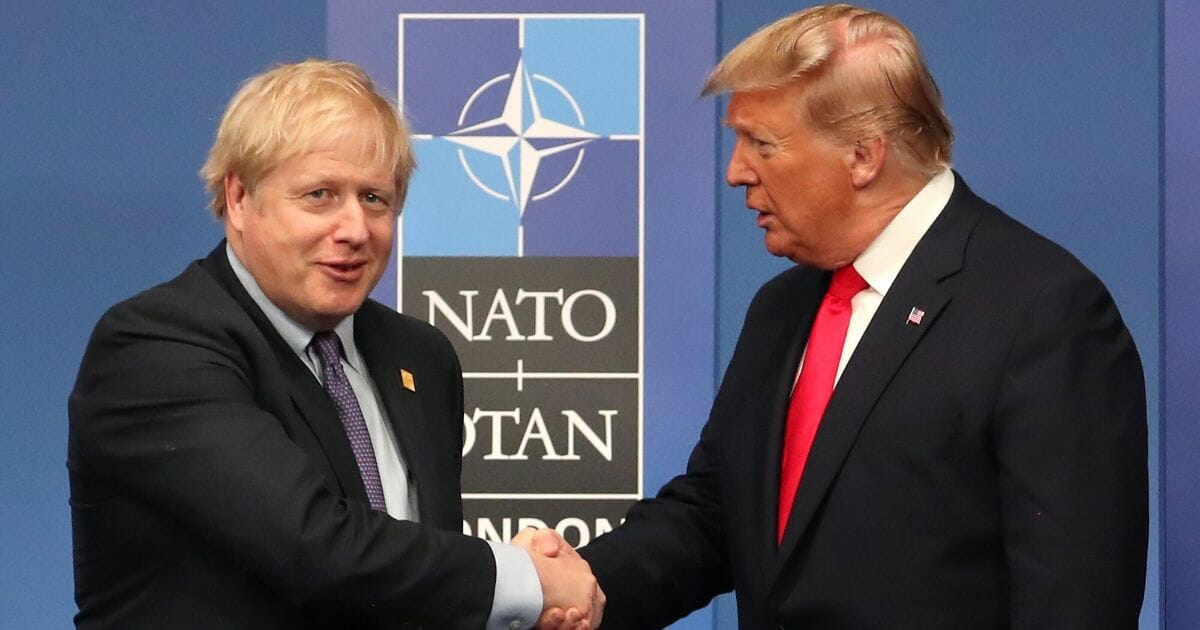 British Prime Minister Boris Johnson shakes hands with U.S. President Donald Trump onstage during the annual NATO heads of government summit on Dec. 4, 2019, in Watford, England.