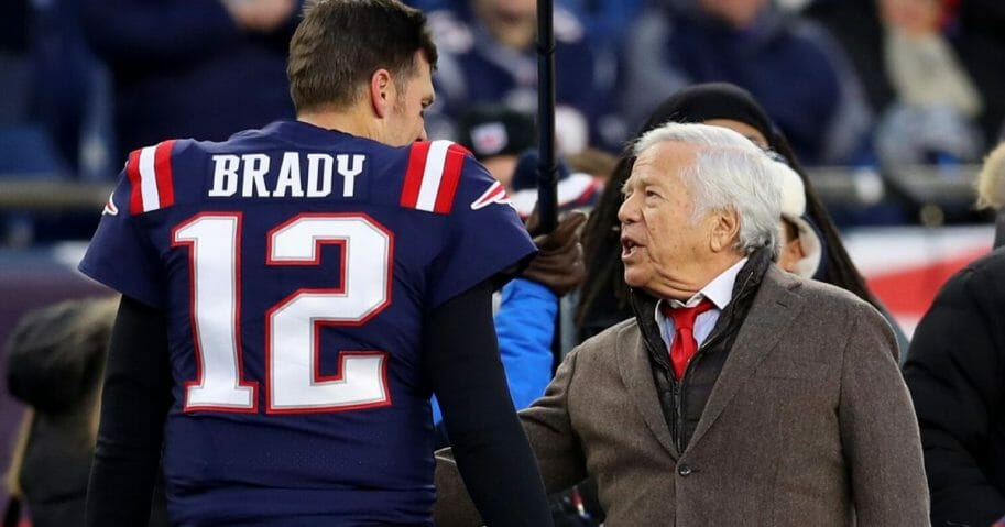 New England Patriots owner Robert Kraft, right, talks with quarterback Tom Brady before the team's game against the Kansas City Chiefs at Gillette Stadium in Foxborough, Massachusetts, on Dec. 8, 2019.