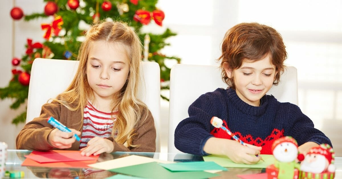 A stock photo of children making Christmas cards is pictured above.