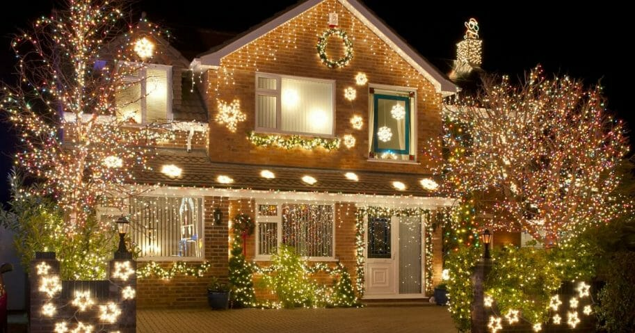 A house decked out in lights.