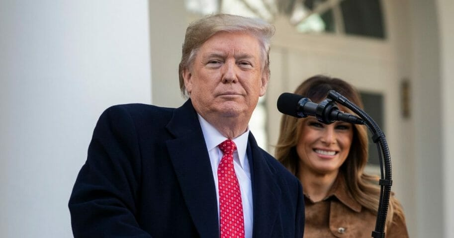 With first lady Melania Trump looking on, U.S. President Donald Trump speaks before giving the National Thanksgiving Turkey Butter a presidential pardon during the traditional event in the Rose Garden of the White House Nov. 26, 2019, in Washington, D.C.