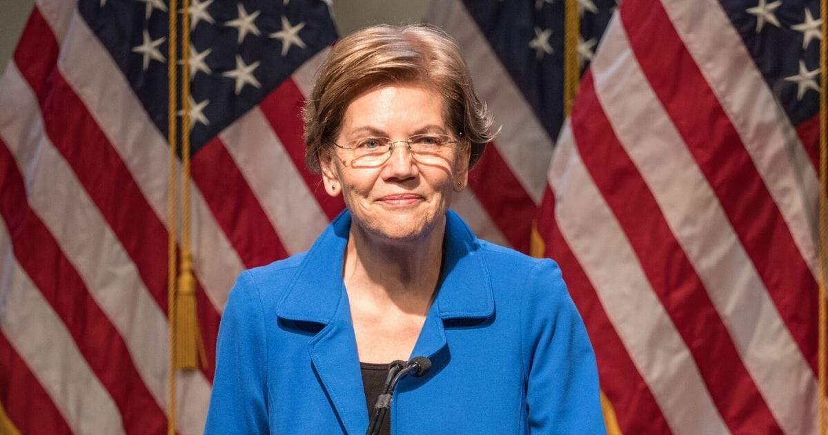 Democratic presidential candidate Sen. Elizabeth Warren gestures as she delivers an economic policy speech on Dec. 12, 2019, in Manchester, New Hampshire.