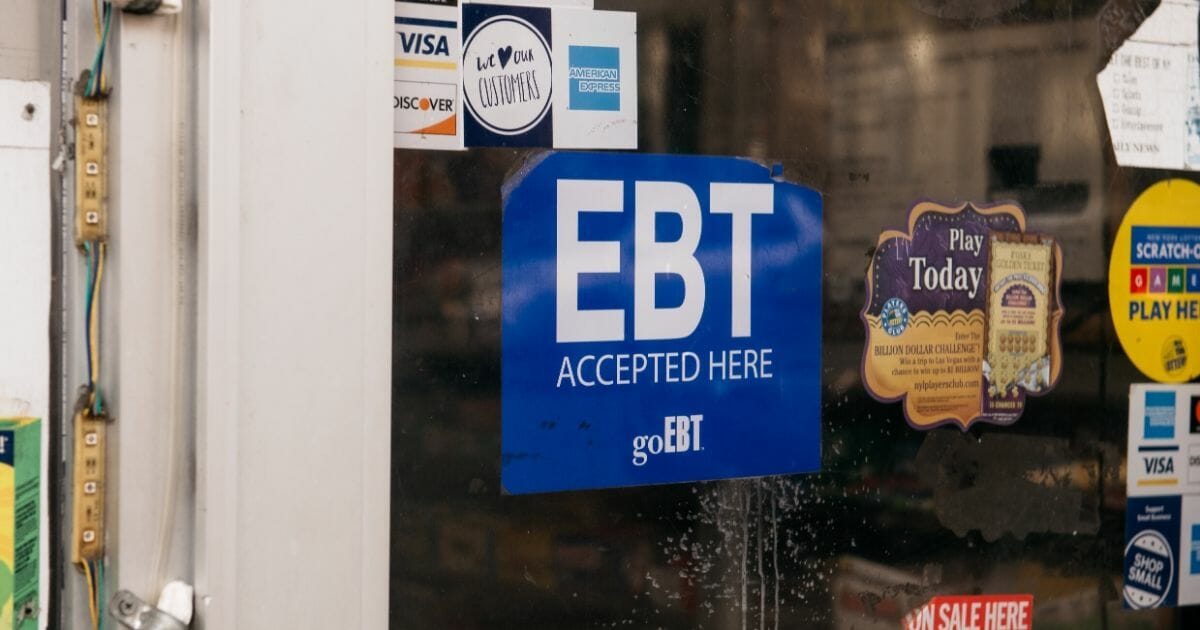 A sign alerting customers about SNAP food stamps benefits is displayed at a Brooklyn grocery store on Dec. 5, 2019, in New York City.