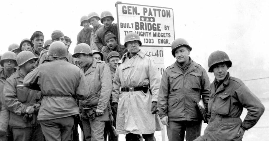 American military commander Lieutenant General George S. Patton -- center, in helmet with three stars -- commander of the 3rd Army, visits men of 1303rd Engineers, whose completed bridge across the Sauer River linked Luxembourg and Germany, on Feb. 20, 1945.