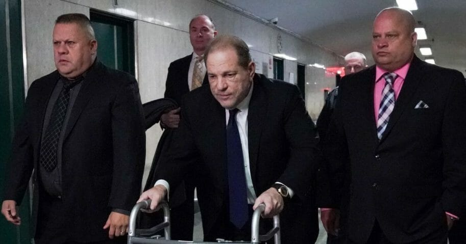 Harvey Weinstein, center, leaves Manhattan Criminal Court, using a walker, following a hearing on Dec. 11, 2019, in New York.
