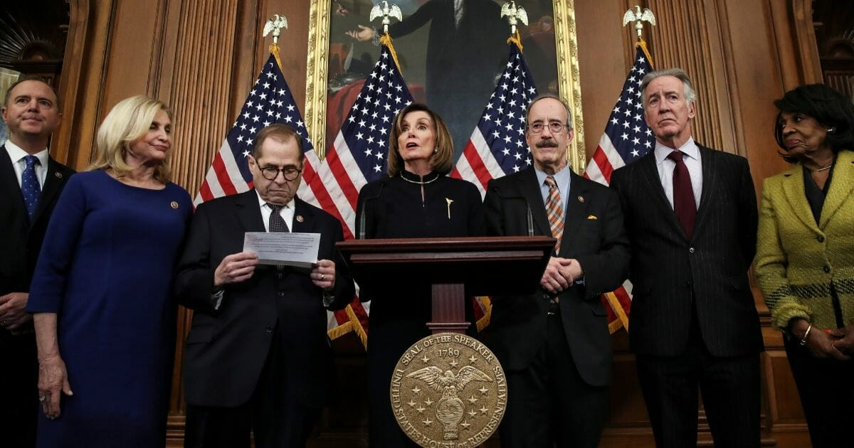 House Speaker Nancy Pelosi of California speaks during a news conference alongside other Democrats at the U.S. Capitol on Dec. 18, 2019, after the House voted to impeach President Donald Trump.