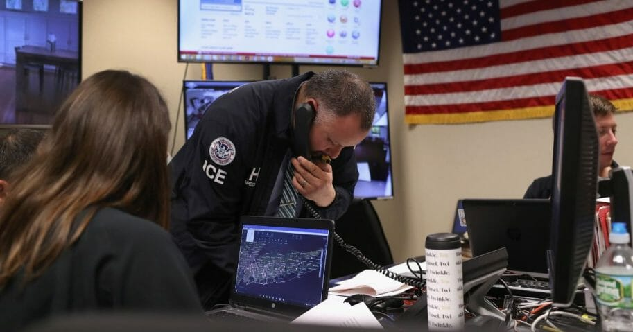 ICE agents working in a control center