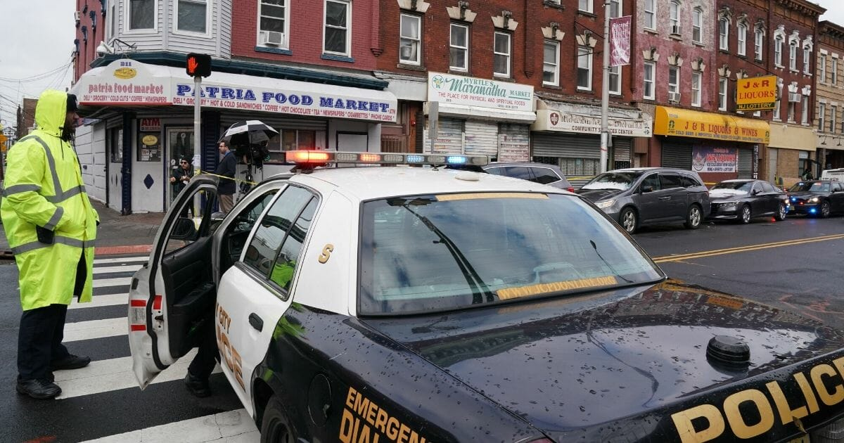 Jersey City Police gather at the scene of the Dec. 10, 2019, shooting at a Jewish deli in Jersey City, New Jersey.