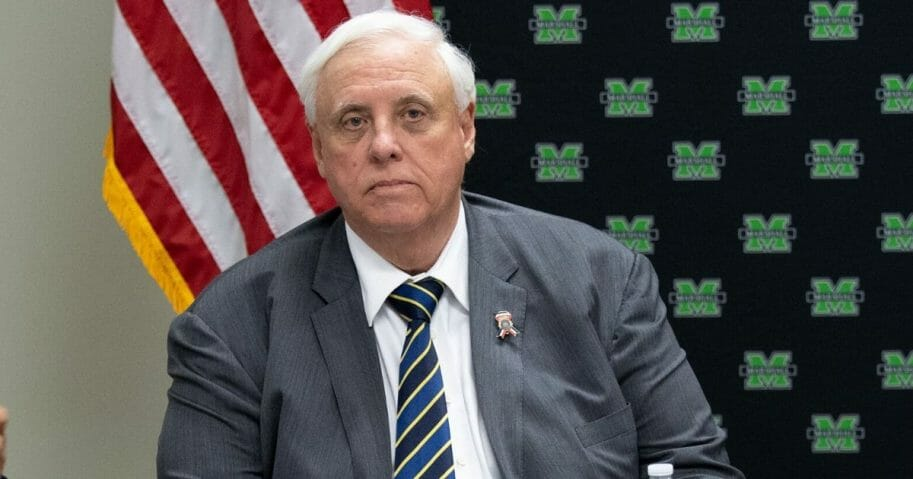 West Virginia Gov. Jim Justice attends a roundtable discussion on the opioid epidemic with local and state officials at the Cabell-Huntington Health Department in Huntington, West Virginia, on July 8, 2019.