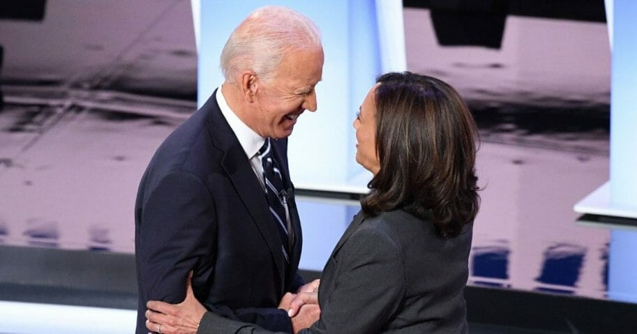 Democratic presidential hopefuls former Vice President Joe Biden, left, and Sen. Kamala Harris greet each other ahead of the second round of the second Democratic primary debate of the 2020 presidential campaign season in Detroit on July 31, 2019.