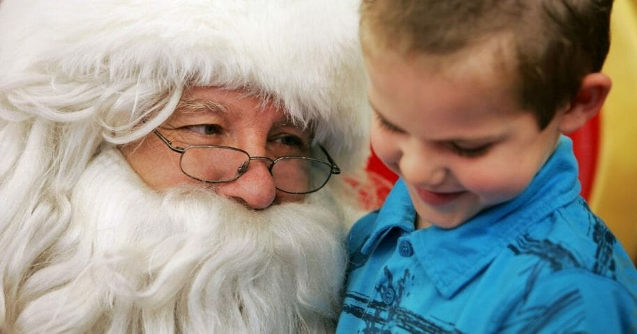 A young boy visits Santa Claus at Stanhope Gardens Shopping Centre in Sydney, Australia.