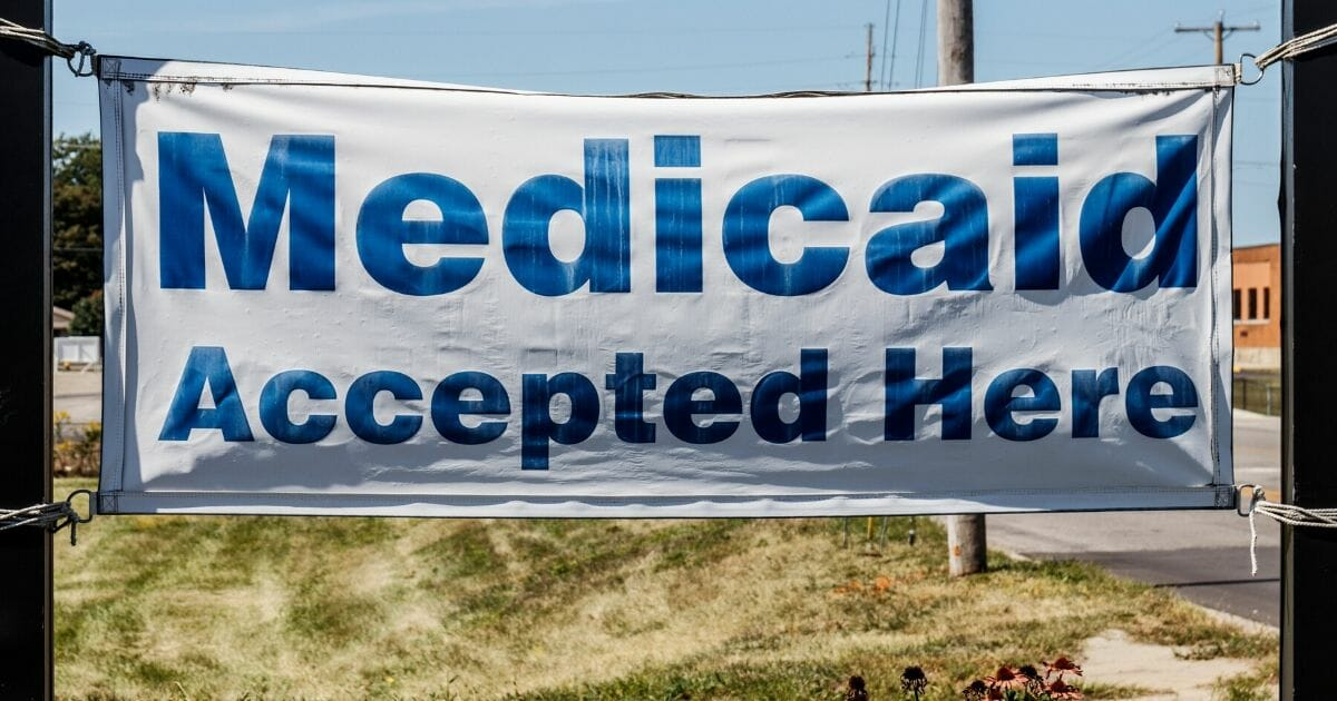 """A stock image of a """"Medicaid Accepted Here"""" sign is seen."""