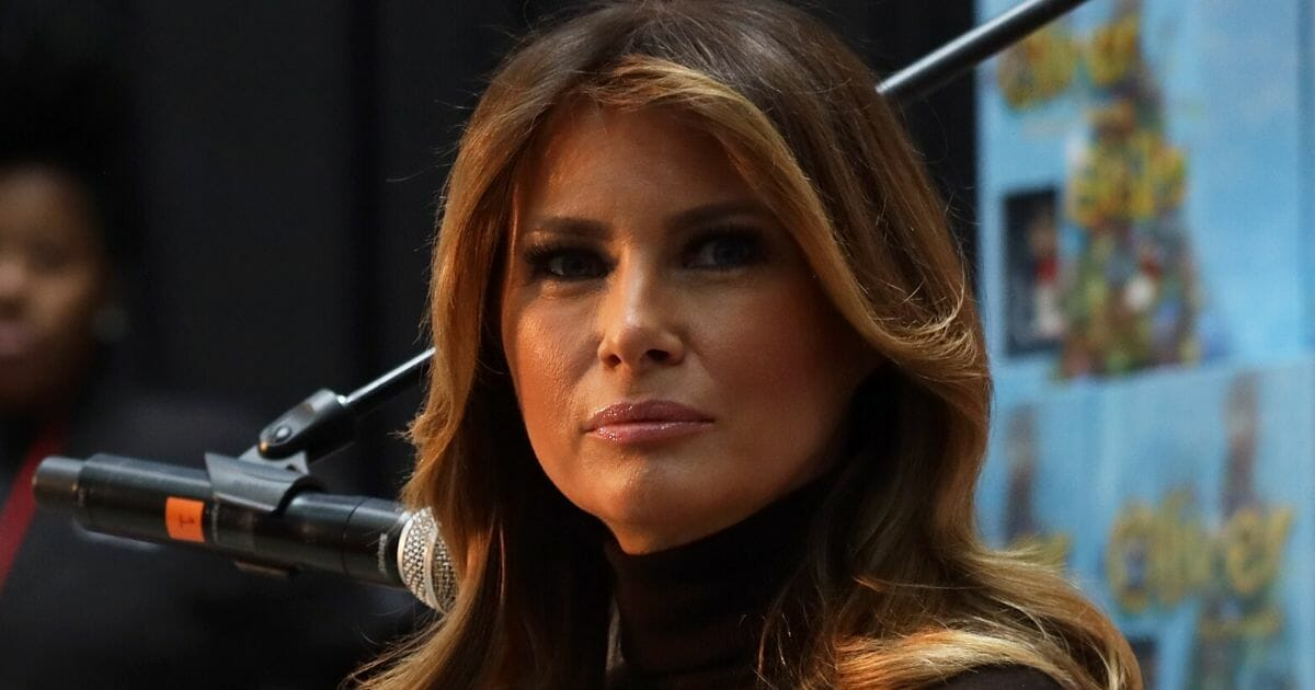 First lady Melania Trump looks on after reading a storybook to patients during her visit to Children's National Hospital in Washington on Dec. 6, 2019.