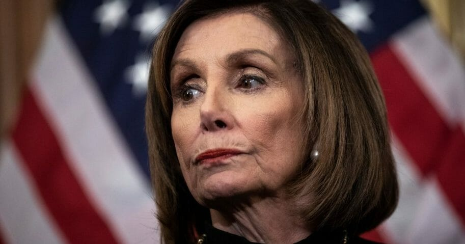 Speaker of the House Nancy Pelosi (D-California) looks on during a news conference after the House of Representatives voted to impeach President Donald Trump at the U.S. Capitol on Dec. 18, 2019, in Washington, D.C.
