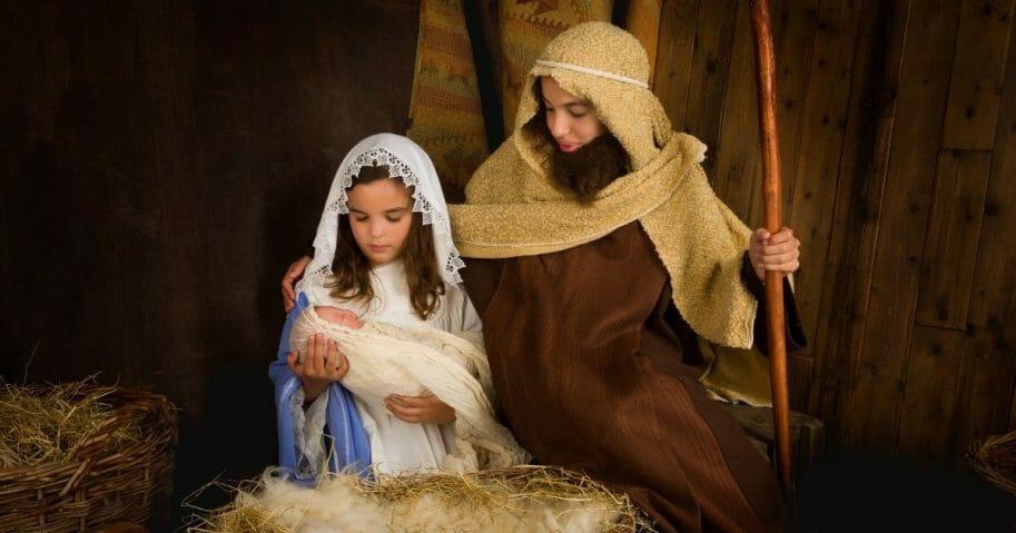 Children re-enact the nativity scene in the stock photo above.