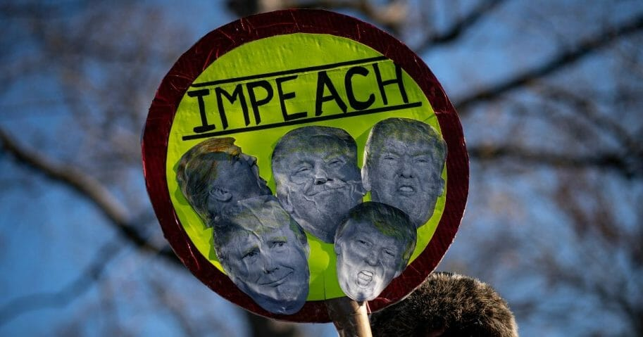 Protesters supporting the impeachment of President Donald Trump gather outside the U.S. Capitol on Dec. 18, 2019, in Washington, D.C.