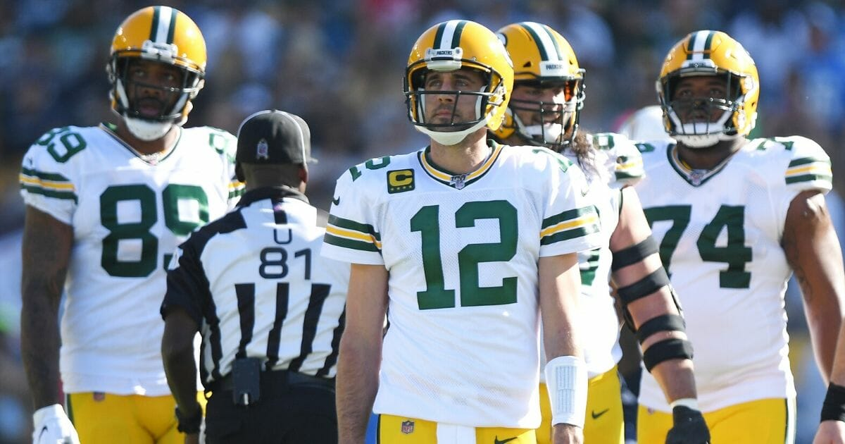 Aaron Rodgers, No. 12, and his Green Bay Packers teammates look on during a Nov. 3, 2019, game against the Los Angeles Chargers at Dignity Health Sports Park in Carson, California.