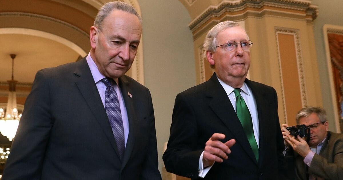 Senate Minority Leader Charles Schumer of New York, left, and Senate Majority Leader Mitch McConnell of Kentucky walk to the Senate Chamber at the U.S. Capitol on Feb. 7, 2018.