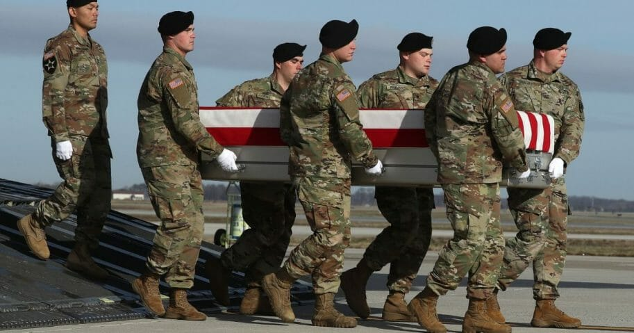 A U.S. Army carry team moves the remains of U.S. Army Sgt. 1st Class Michael Goble during a dignified transfer at Dover Air Force Base in Delaware on Dec. 25, 2019