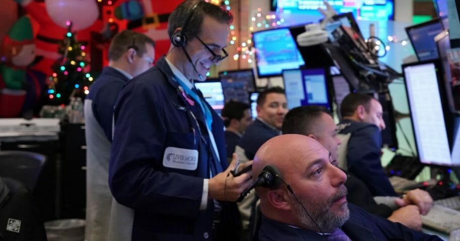 Traders work on the floor at the closing bell of the Dow Industrial Average at the New York Stock Exchange on Dec. 5, 2019, in New York.