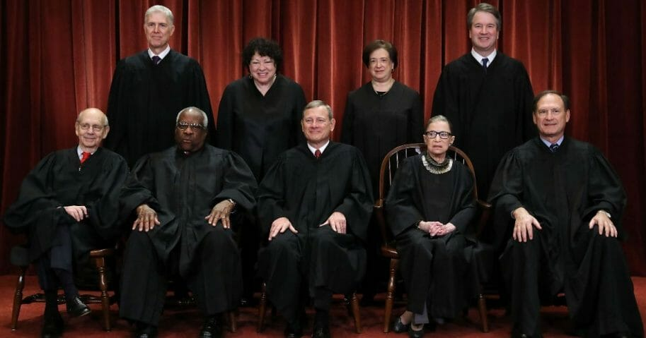 The Supreme Court justices pose for their official portrait in the East Conference Room at the Supreme Court building on Nov. 30, 2018, in Washington, D.C.