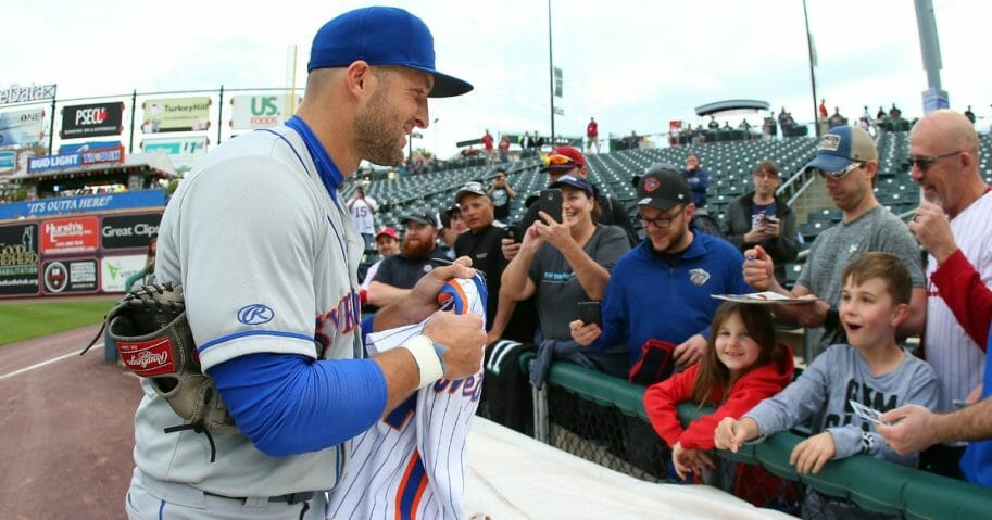Tim Tebow of the Triple-A Syracuse Mets signs autographs before a game against the Lehigh Valley Iron Pigs on April 30, 2019, at Coca Cola Park in Allentown, Pennsylvania.