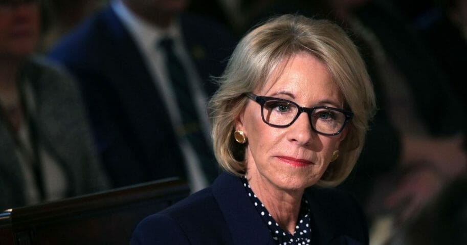 Secretary of Education Betsy DeVos listens during an Interagency Working Group on Youth Programs meeting at the State Dining Room of the White House on March 18, 2019, in Washington, D.C.