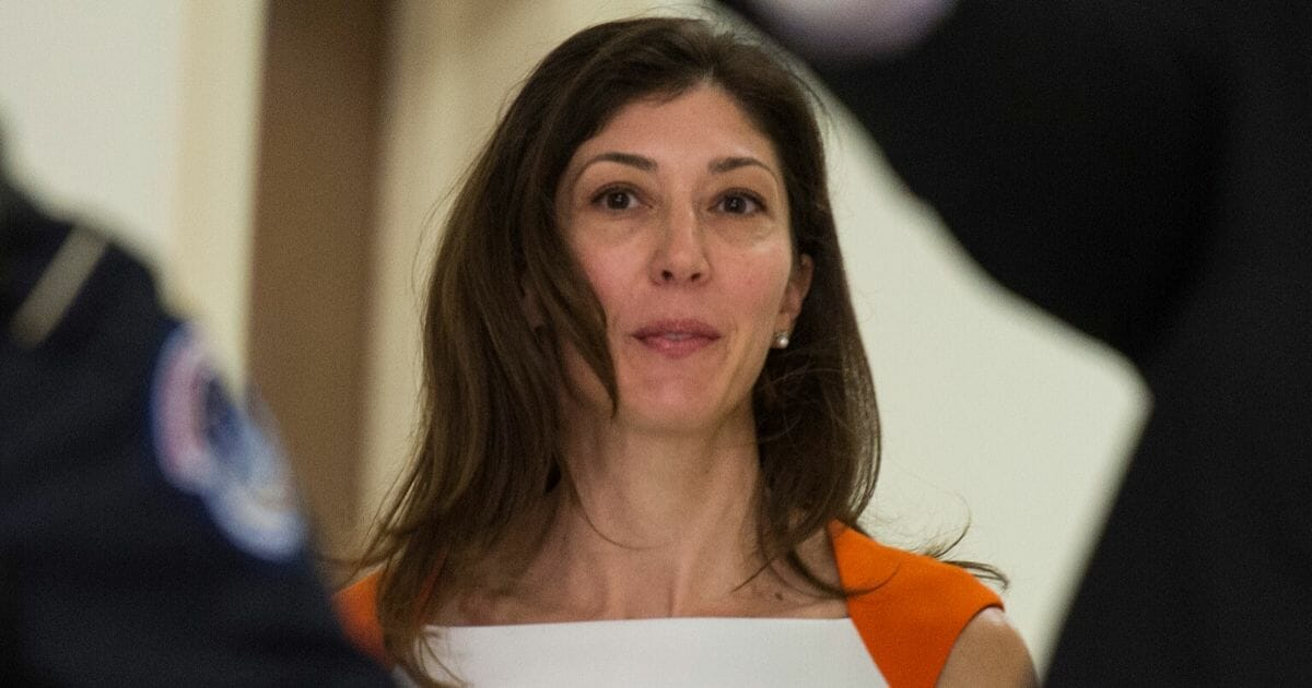 Former FBI attorney Lisa Page is pictured in a file photo heading to an appearance before the House Judiciary and Oversight committees on Capitol Hill in Washington in December 2018.