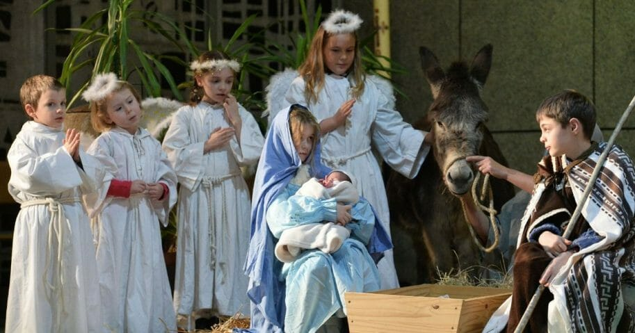 Children perform a nativity scene on Christmas Eve at the Saint-Liboire Church in Le Mans, France, on Dec. 24, 2017.