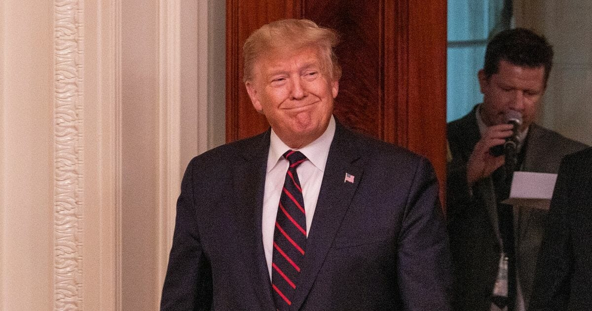 President Donald Trump grins in a file photo at the White House from Oct. 16.