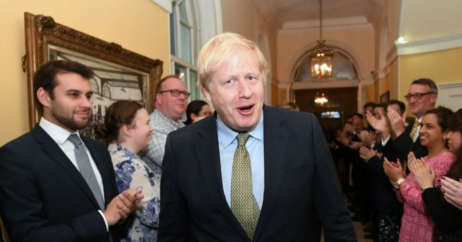 Prime Minister Boris Johnson arrives back at 10 Downing Street after visiting Buckingham Palace, where he was given permission to form the next government during an audience with Queen Elizabeth II on Dec. 13, 2019 in London.