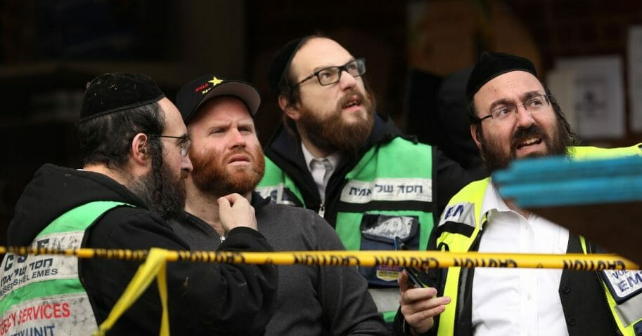 Recovery and clean-up crews work the scene in the aftermath of a mass shooting at the JC Kosher Supermarket on Dec. 11, 2019, in Jersey City, New Jersey.