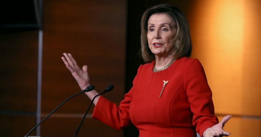 House Speaker Nancy Pelosi gestures Thursday during a news conference on the day after the House approved articles of impeachment against President Donald Trump.