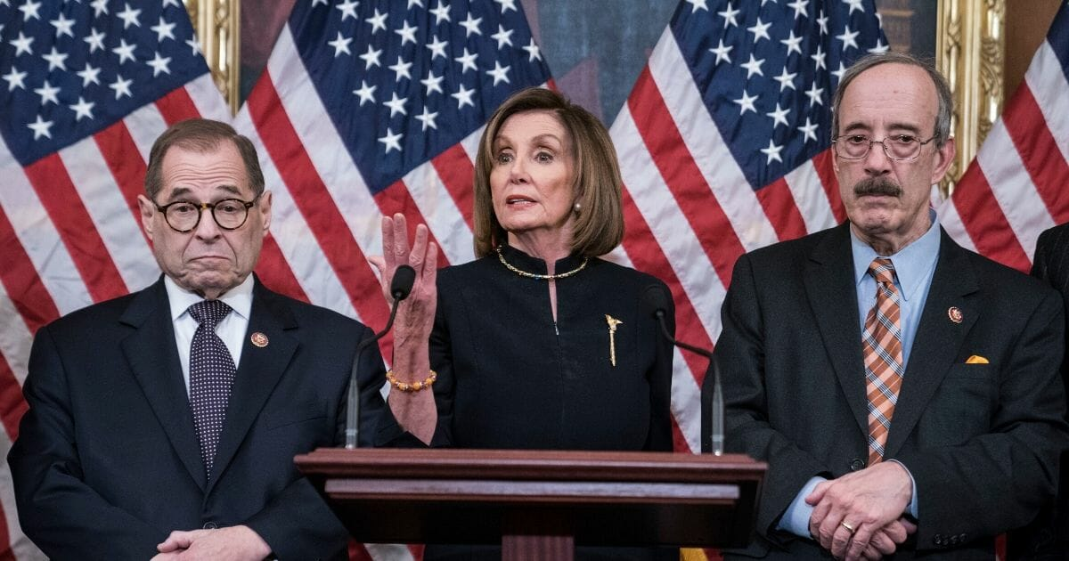 Speaker of the House Nancy Pelosi delivers remarks alongside House Judiciary Committee Chairman Jerry Nadler and House Foreign Affairs Chairman Eliot Engel following the House's vote to impeach President Donald Trump on Dec. 18, 2019, in Washington, D.C.