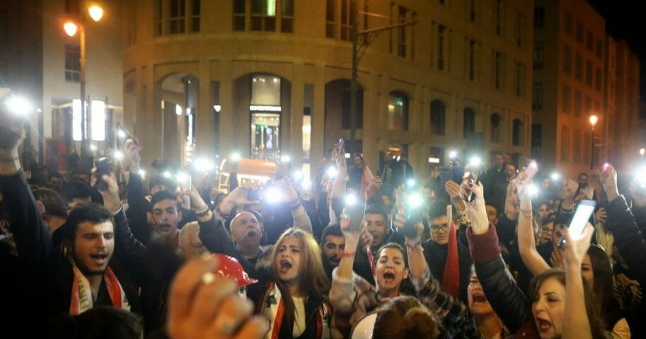 Lebanese anti-corruption protesters shout slogans outside the parliament to denounce the nomination of Prime Minister-designate Hassan Diab in Beirut on Dec. 19, 2019.