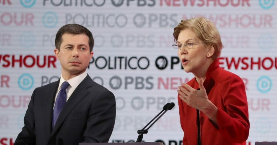Massachusetts Sen. Elizabeth Warren speaks as South Bend, Indiana, Mayor Pete Buttigieg listens during the Democratic presidential primary debate at Loyola Marymount University on Dec. 19, 2019, in Los Angeles.