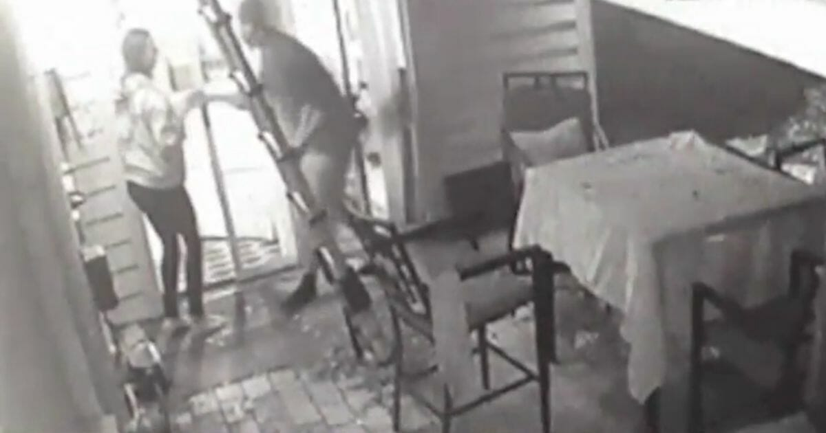 A home intruder grabs 11-year-old Ava Kloepfer by the arm at her Ormond Beach, Florida, residence.