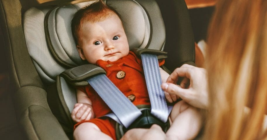 Stock image of a baby in a car seat.