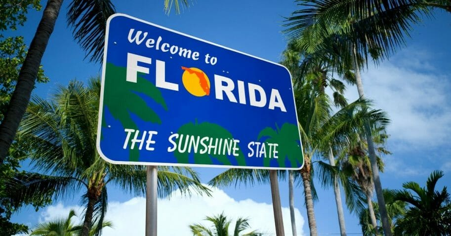 "A ""Welcome to Florida"" greets visitors to the Sunshine State."