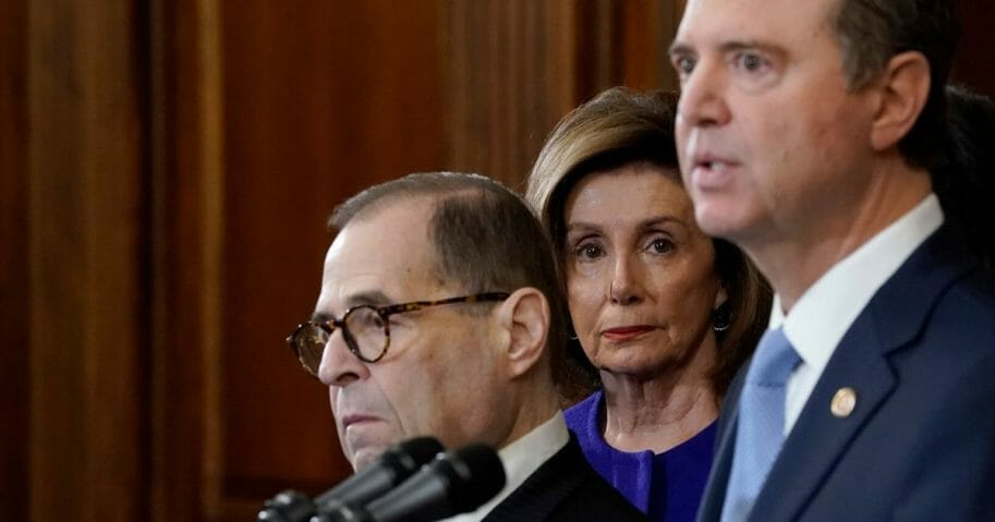 Speaker of the House Nancy Pelosi listens as Reps. Adam Schiff of California, right, and Jerry Nadler of New York announce the next steps in the House impeachment inquiry at the U.S. Capitol on Dec. 10, 2019 in Washington, D.C.