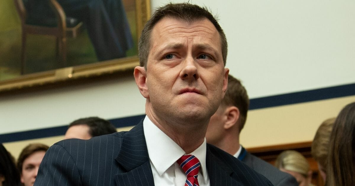 Former FBI Agent Peter Strzok frown while preparing to testify in the House of Representatives in July 2018.