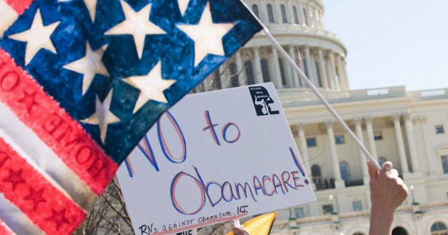 Supporters of the tea party movement demonstrate against the Obamacare health care bill outside the U.S. Capitol in Washington, D.C., on March 20, 2010.