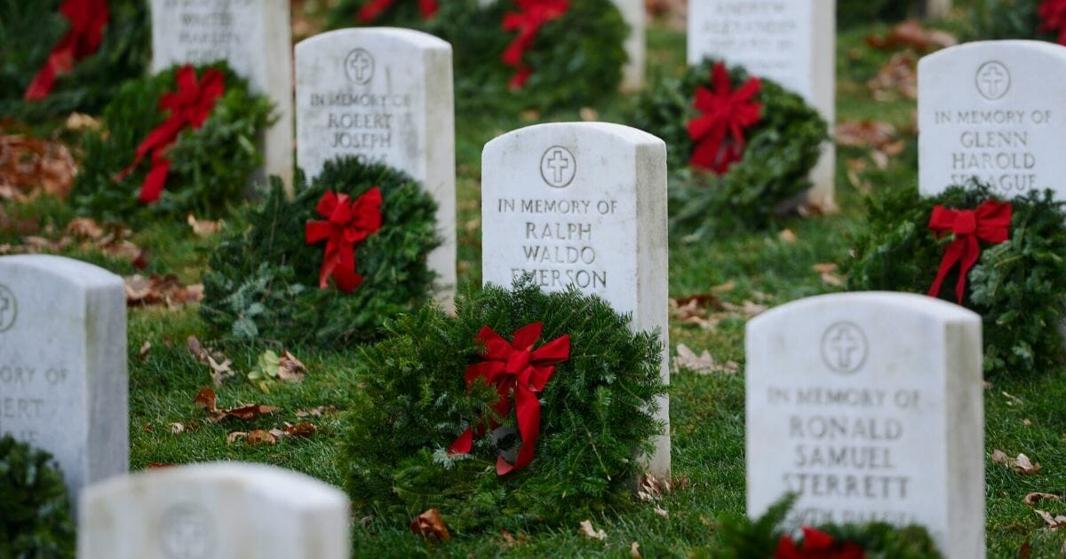 More than 50,000 anticipated volunteers placed remembrance wreaths on the nearly 245,000 headstones in Arlington National Cemetery on Dec. 17, 2016 in Arlington, Virginia.